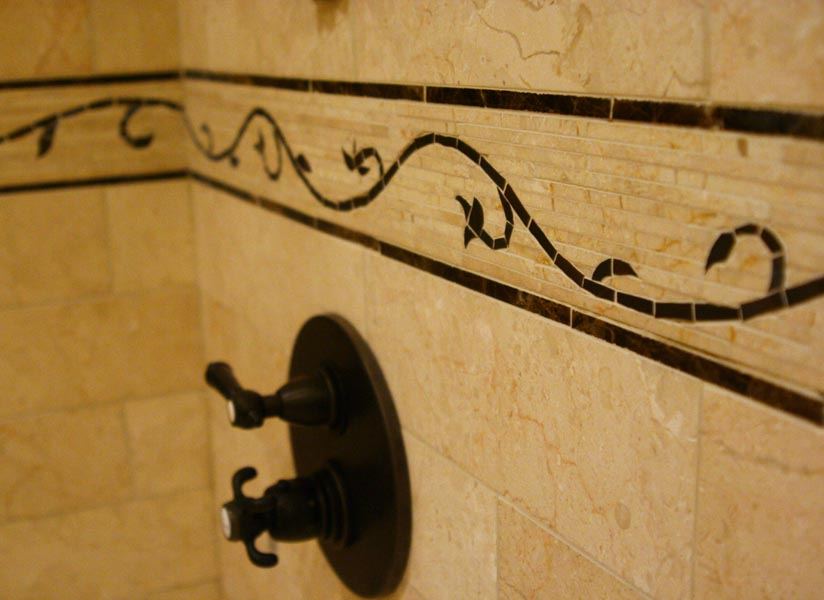 Glass tile mosaic and marble mosaic shower